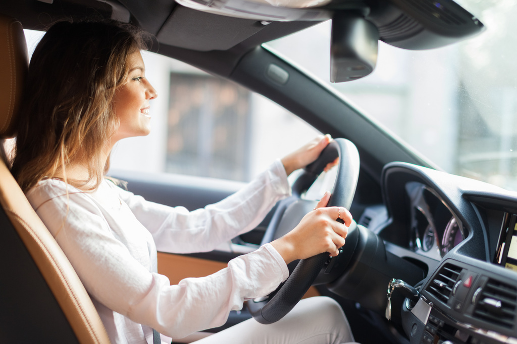 Young woman driving first car purchase