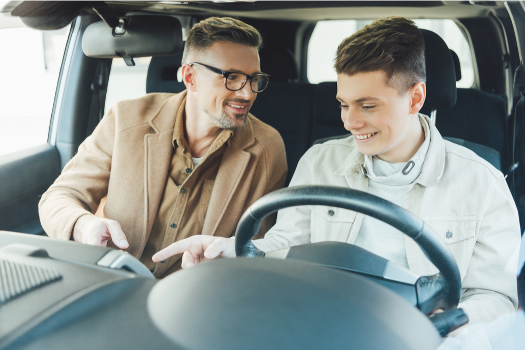 Father and son in dealership car